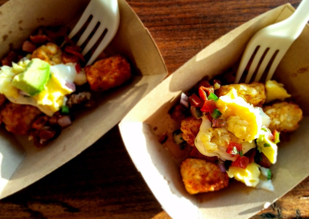 """""""Tatchos"""" (my favorite!) tater tots topped with bacon, sausage, ham, queso, pico de gallo, and avocado"""